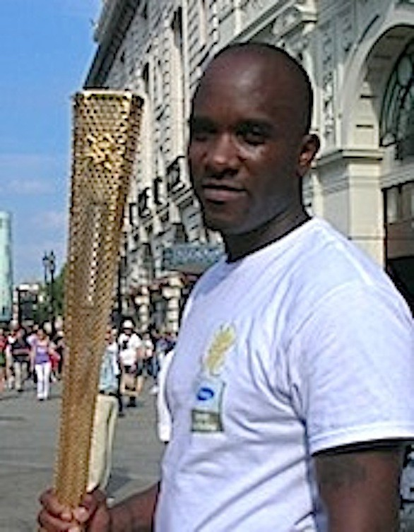 Phoenix James with the Olympic Torch in London